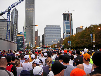 7:57am. What it looks like from the Preferred Start area. Perhaps 5,000 athletes ahead and 30,000 athletes behind, waiting to go. The small green banner in the distance -- that's where it all begins: the starting line.
