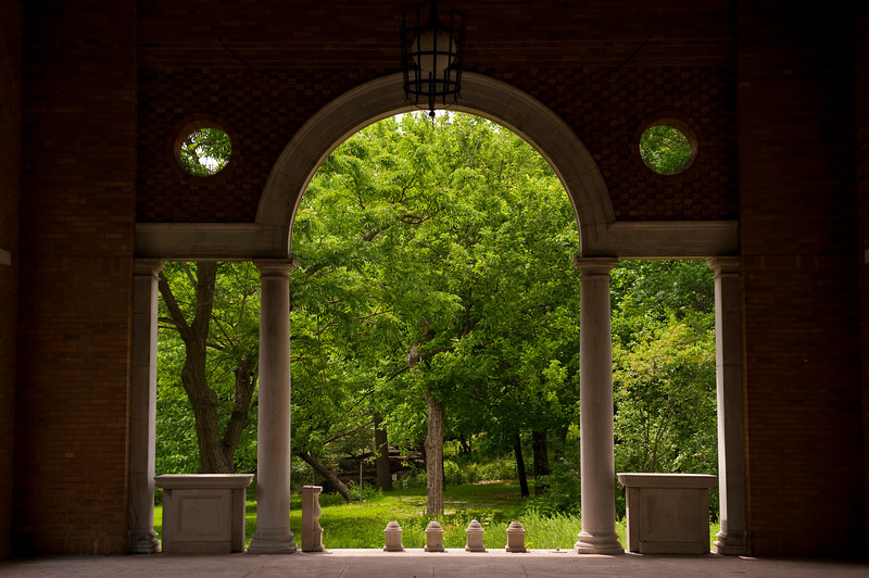 A view in to Columbus Park as framed by the south terrace archway of the Columbus Park Refectory.