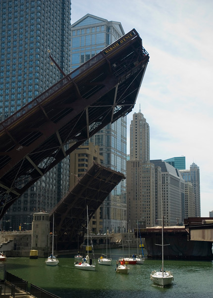 Bridges up as sailboats head down river from Lake Michigan