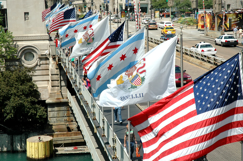 Flags fly over the Chicago River at Michigan Avenue Bridge