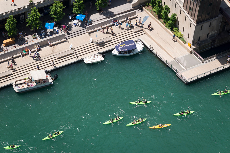 Aerial of kayakers kayaking near Chicago River Riverwalk Marina Plaza summer tourism