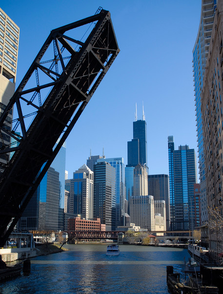 View of the Chicago River and the skyline with a raised bridge from the west end of downtown.