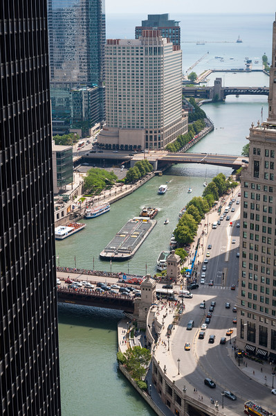 Chicago River and industry industrial barge traffic navigating aerial