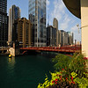 The United Building, formerly R. R. Donnelley Center, along the Chicago River with flower boxes as seen from Marina City.