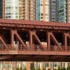 Bicyclist travel across the Chicago River and the Lake Shore Driver double decker two level bridge.