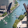 Aerial view of the Chicago River with lifted bridge and boats