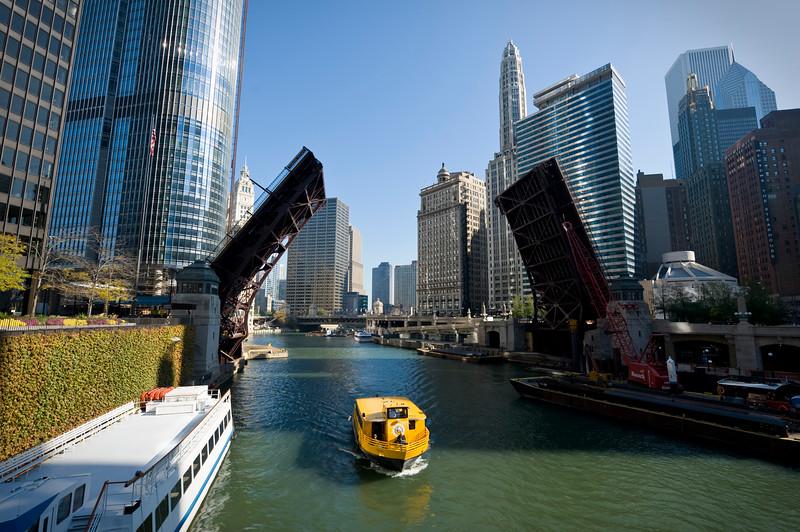 Bridges up as a tour boat heads down river
