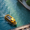 Aerial Chicago Water Taxi passing Wabash Avenue bridge