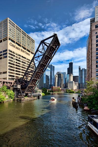 Boat and Chicago Skyline at Kinzie Street Bridge
