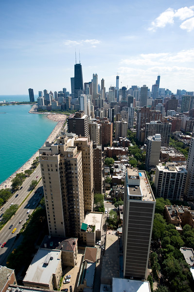 Skyline view from Gold Coast, showing buildings, Lake Shore Drive and Lake Michigan.