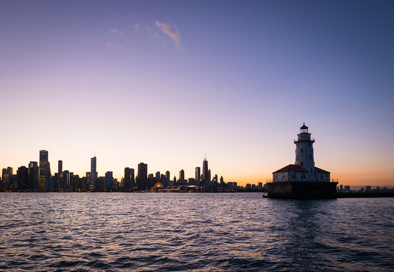 Lake Michigan, the Chicago skyline and Chicago Harbor Lighthouse at sunset