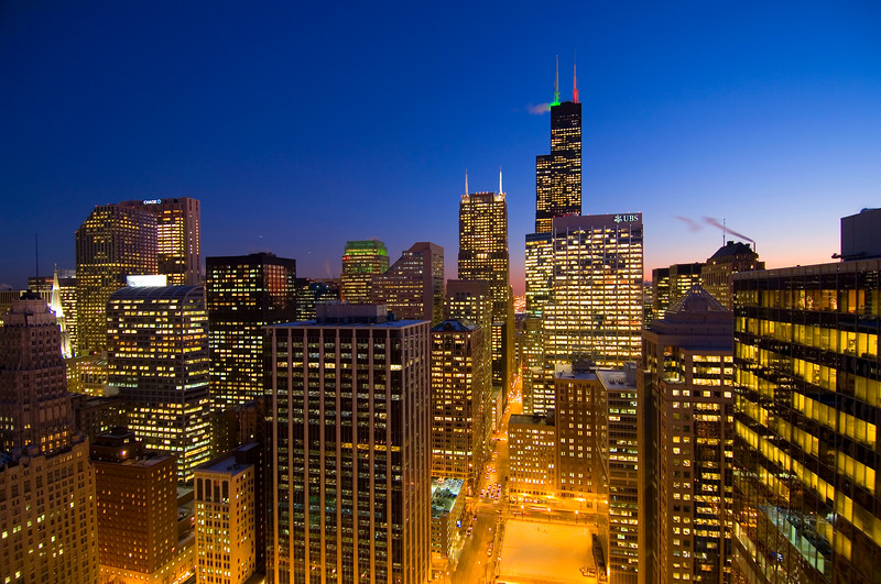 Aerial view of downtown Chicago at dusk.