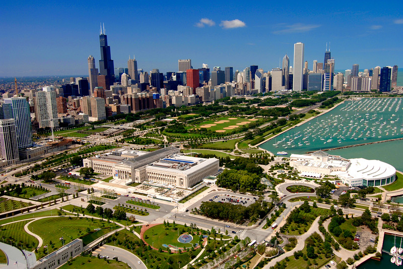 Aerial view of downtown Chicago with the Museum Campus in the foreground.