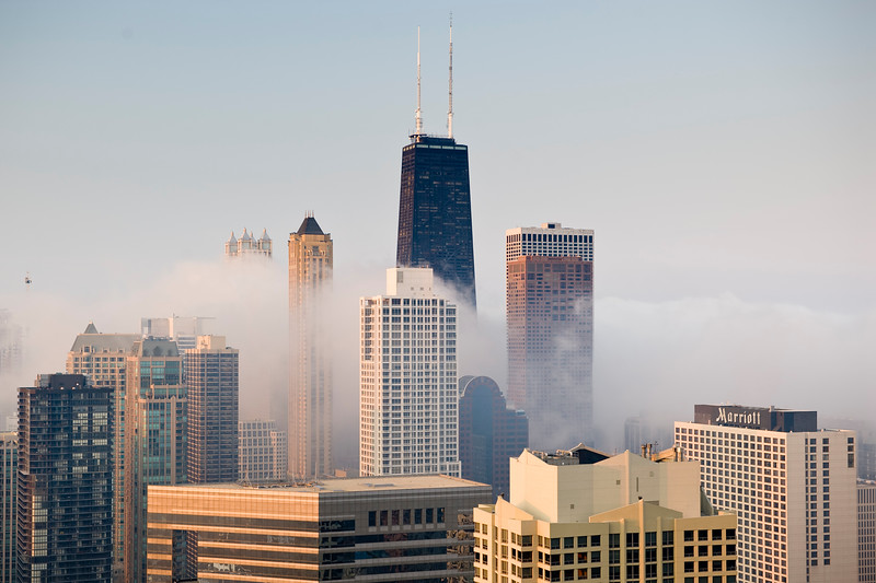 Aerial view of buildings and fog