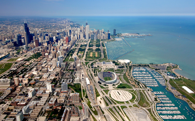 Aerial view of Chicago. including Soldier Field, and Lake Michigan.