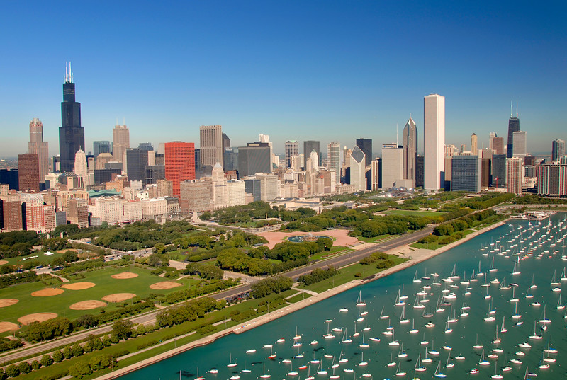 Aerial view of sail boats in Lake Michigan, Grant Park and Chicago's skyscrapers.