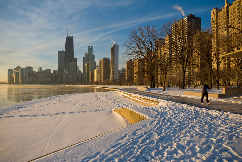 View of Chicago and snow covered lake front in winter