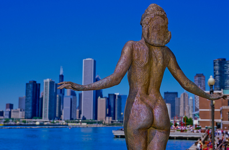 Statue on Navy Pier looking over skyline