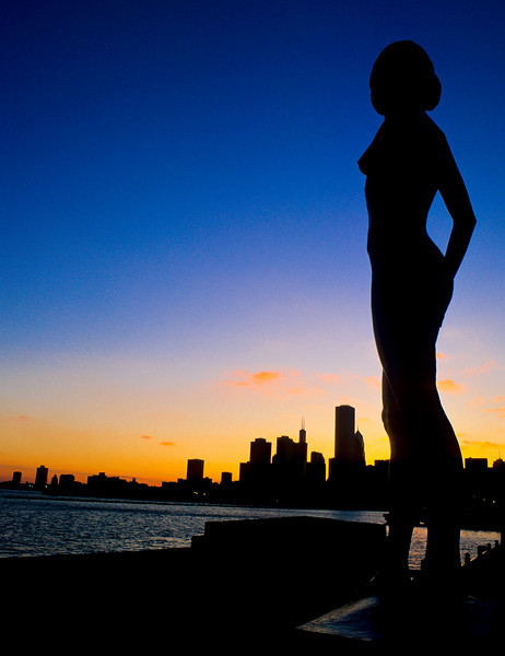 Skyline at sunset from Navy Pier with Statue in foreground