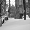 A back alley had snow drifting up to the top of 4' dumpsters!