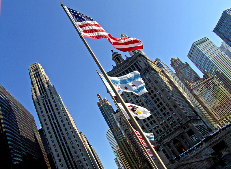 American and City of Chicago Flags on a windy day over the Chicago River