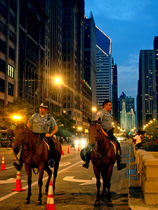 03july06  Every year after the Taste of Chicago on July 3rd, the city has a huge fireworks display where over 3 million people come downtown to watch.  This year the city closed down Michigan Avenue to make room for the crowds which I have never seen before but was a very cool site.  All along Michigan Ave, cops on horses were stationed for crowd control etc.  I happen to like this view from the middle of the street immensely but its usually  immpossible to photograph because of all the traffic.