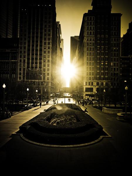 View west into sun at Millenium Park entrance.