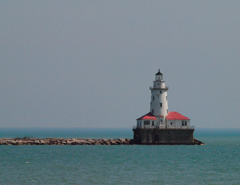 Lighthouse at the breakwater jetties at Chicago harbor