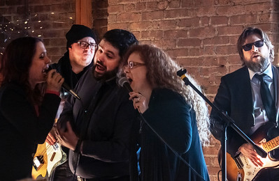 Danielle Nicole sings with Mike Welch and Kit Holliday; Dan Carelli (far right)