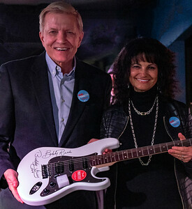 Mayoral Candidate Bob Fioretti with Ms. Hilton, who won the guitar raffle