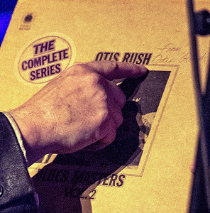 Curtis Salgado shows where Otis Rush autographed his record.