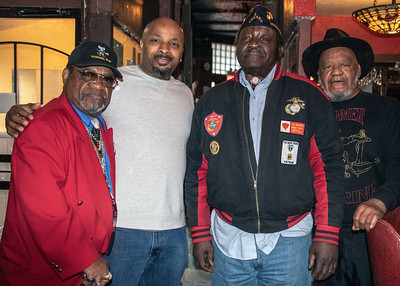 A few of the marines from Montford Point pose with Water Hole owner, Tony (far right(