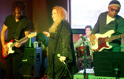 Jan James with her band