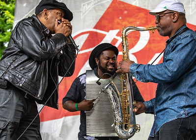 Sugar Blue with washboard player and sax player (Terrance Simien and the Zydeco Experience) | Budweiser Crossroads Stage