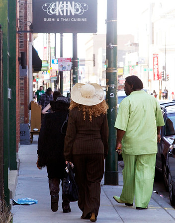 "Mud Morganfield and family strolling down the street. Funny that the sign above says, ""Kin."""