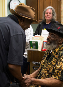 Lurrie Bell (l) chats with Eddie C. Campbell