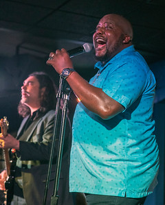Sugaray Rayford with Alistair Greene in background