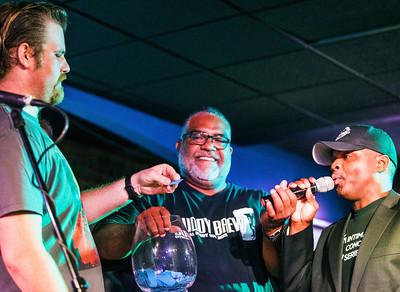 Jon Trout (l) picks the winner of the signed Buddy Guy guitar