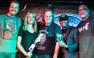 Guitar winner (2nd from l) poses with (l-r) Jon Trout, Walter Trout and Legends MC Johnny and a Legends staff member