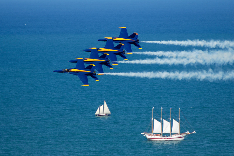 Blue Angels race across the sky in tight formation during Chicago's Air and Water Show