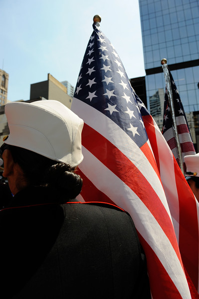 A member of the JROC Honor Guard carries the U.S. Flag during the annual Memorial Day Ceremonies held at Daley Plaza.