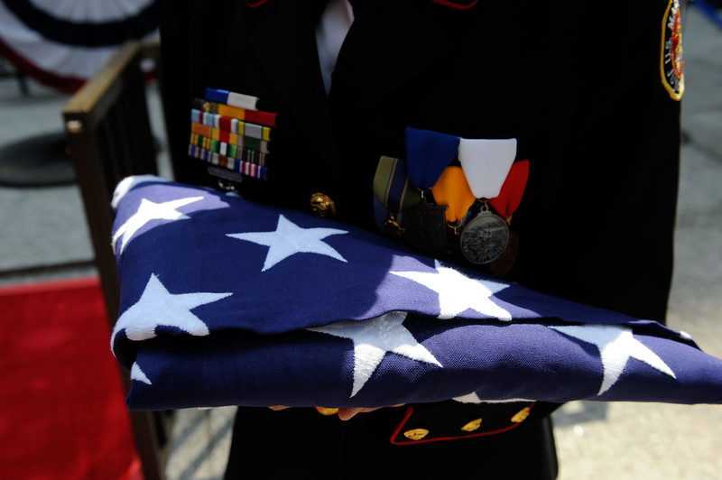 A member of the JROC Honor Guard holds a folded U.S. Flag during the annual Memorial Day Ceremonies held at Daley Plaza.