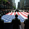Members of the JROTC carry a huge U.S. Flag as they march down State Street during the annual Memorial Day Parade.