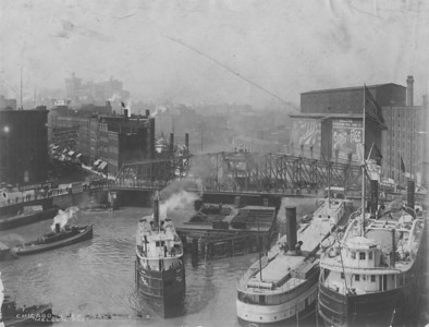 The swing bridge at Rush Street was rebuilt after the 1871 Chicago Fire. At the turn of the last century, the movable bridge still operated on a Chicago River busy with a wide range of shipping, as seen here in a photograph taken around 1900.   http://encyclopedia.chicagohistory.org/pages/10624.html
