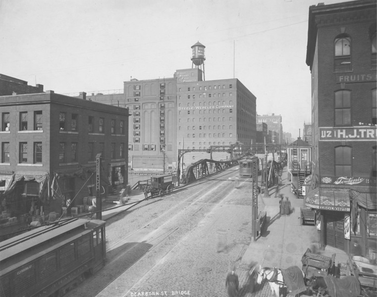 This 1918 photograph shows the approach to the Dearborn Street Bridge looking north across the Chicago River. Note both the horse drawn wagons and the electric streetcars in use.  Photographer: Unknown Source: Chicago Historical Society (ICHi-37375)   http://encyclopedia.chicagohistory.org/pages/10800.html