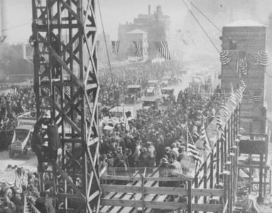 "At 4:00 p.m. on the sunny afternoon of May 14, 1920, Chicago Plan Commission Chairman Charles Wacker and Board of Local Improvements President Michael Faherty stood beside Mayor William Hale ""Big Bill"" Thompson as he cut the ribbon to open the upper level of the new Michigan Avenue Bridge. The sporty Thompson doffed his cowboy hat, the crowd pressed up against ropes that were there to contain it, fireworks were shot into the sky, planes dropped booster literature, boats in the river sounded their whistles, and a band played ""The Star-Spangled Banner."" Workers on the still uncompleted lower level remained busily on the job during the ceremonies.  Photographer: J. Sherwin Murphy Source: Chicago Historical Society (ICHi-29306)   http://encyclopedia.chicagohistory.org/pages/10487.html"