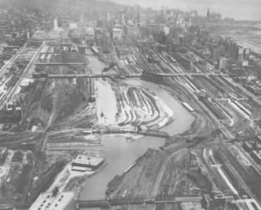 This photograph was taken in 1929, a year before the river-straightening project was completed. The view is from the south toward downtown, and at this point is it possible to see both the river's old path and its new one. The photograph also makes evident how much of the real estate in this area was devoted to railroad tracks and yards.  Photographer: Chicago Aerial Survey Company Source: Chicago Historical Society (ICHi-05776)    http://encyclopedia.chicagohistory.org/pages/10583.html