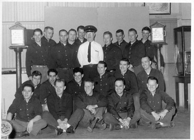 My Grandfather Joe was the Drill Master for the CFD & my Uncle Paul is on the right standing with his arm around the fire alarm box.  Class of January '59