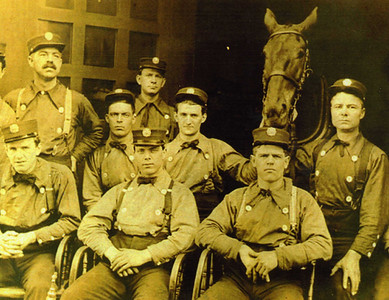 Firefighter Frank Enright (Great Grandfather) Center holding horse
