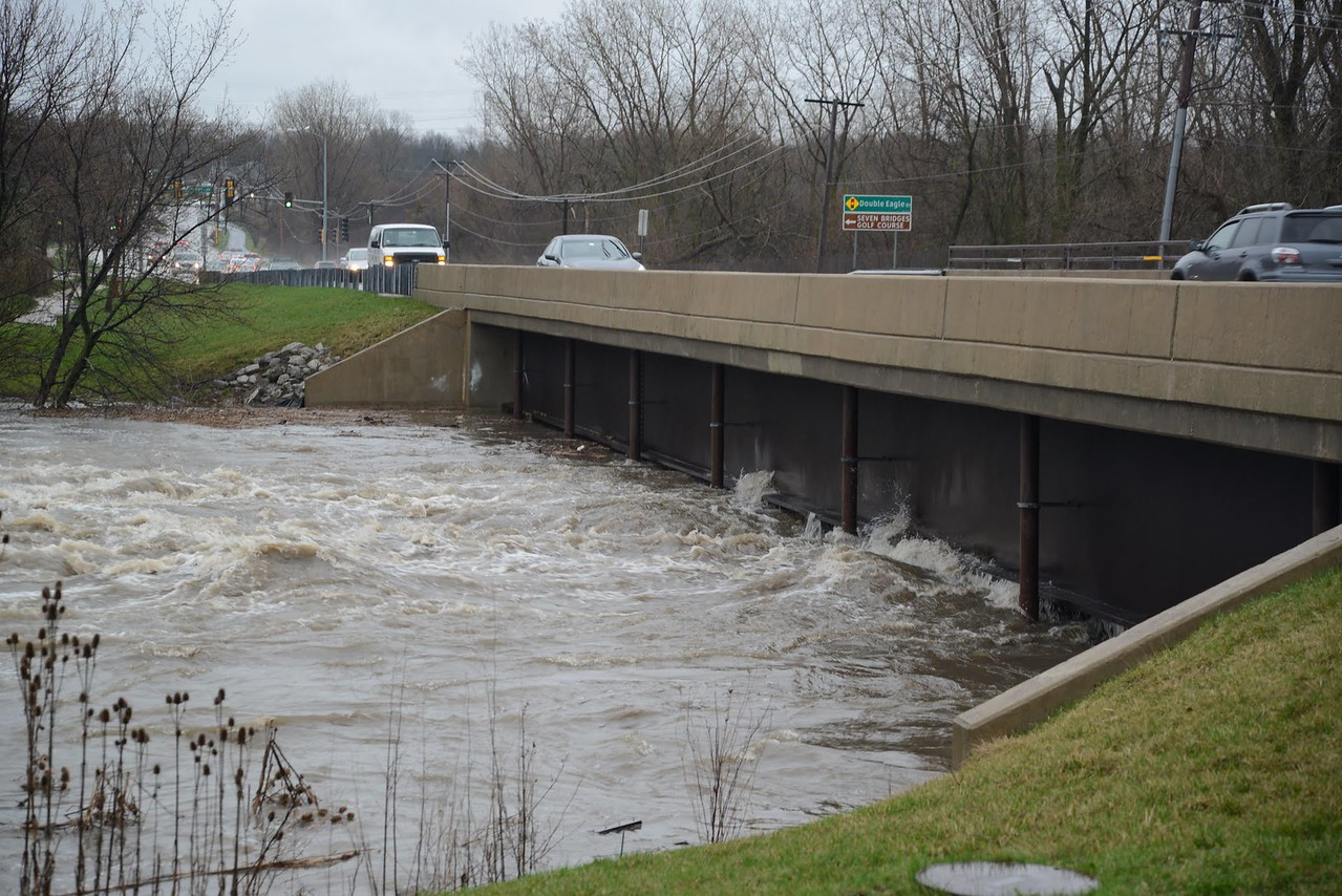 River boiling under the bridge on Hobson Road in Lisle IL near Route 53